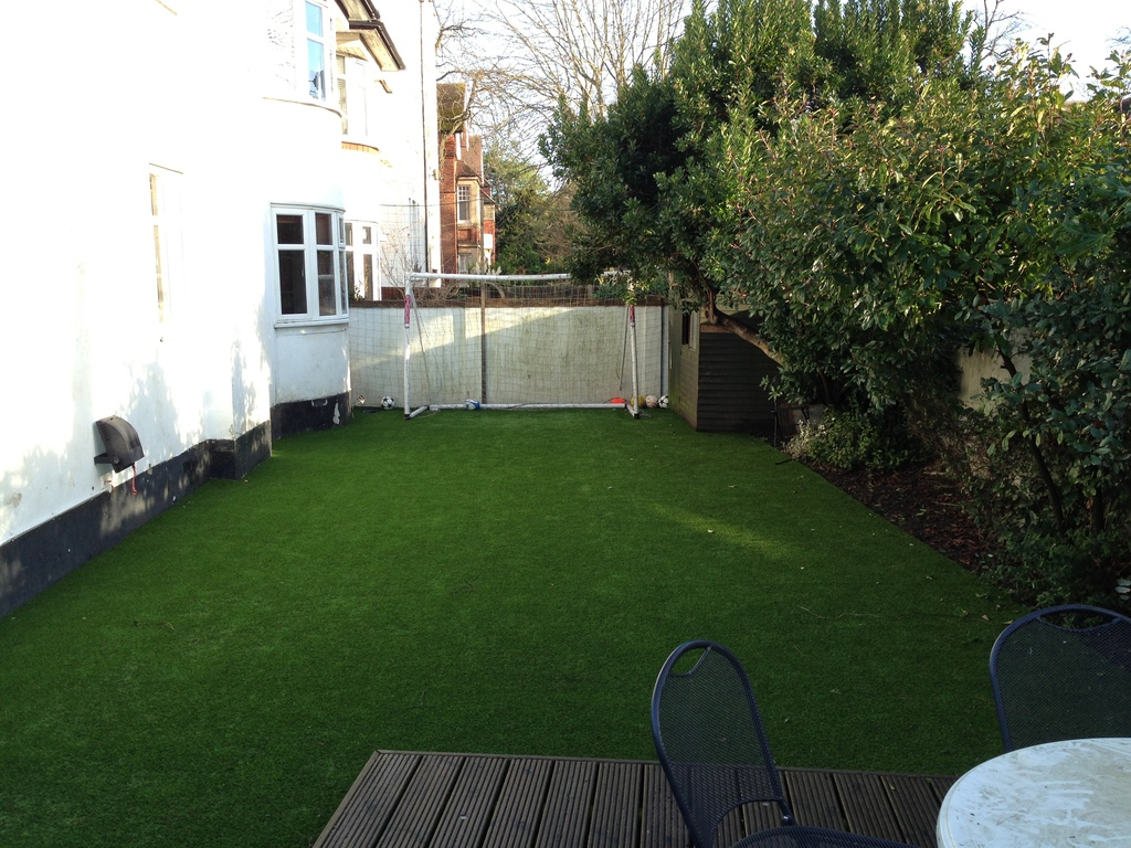 garden with astro turf and patio