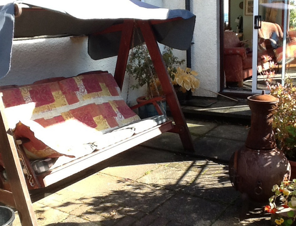 Swinging seat on the patio