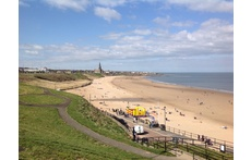 Tynemouth Longsands, this is the beach directly outside our house. It has a cafe open all year round. Surf lessons from Easter to October and surf hire all year round - people surf every day!