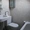 The second bathroom with a bath tub