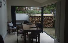 The dining room with bifold doors