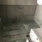 Walk-in shower in renovated bathroom
