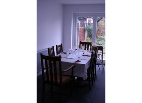 The dining area, with concertina doors onto patio