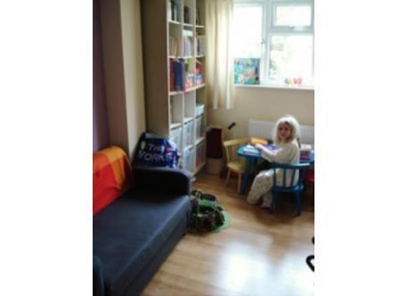 The play room, which has a small sofa bed