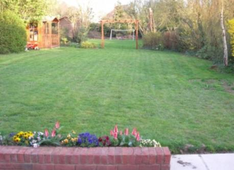 Lovely garden with football pitch at rear