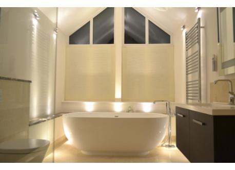 Master bathoom at night with bath and walk-in shower