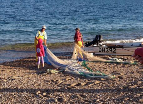 Helping the fishermen at Torcross beach, 15 minutes away.
