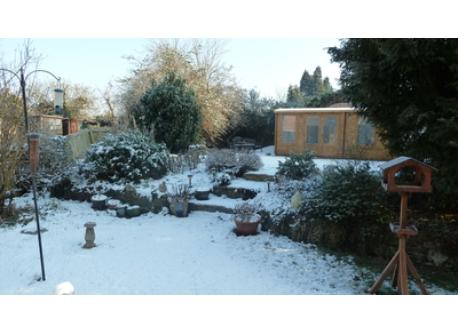 A snowy view of our games/garden room and patio