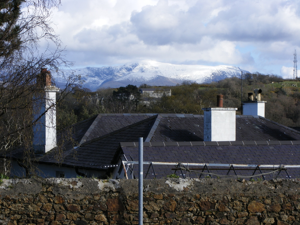 View of house roof and mountains beyond