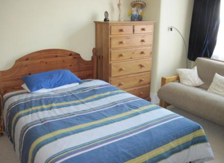 First Floor bedroom with double bed and double futon