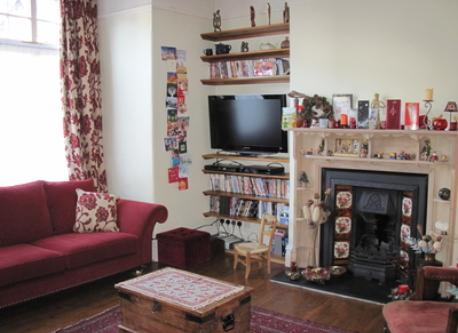 First sitting room with HD TV, blu-ray player, PVR.