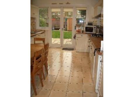 Kitchen with all modern appliances.  It opens onto the garden.