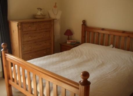 Top floor bedroom with king size bed.