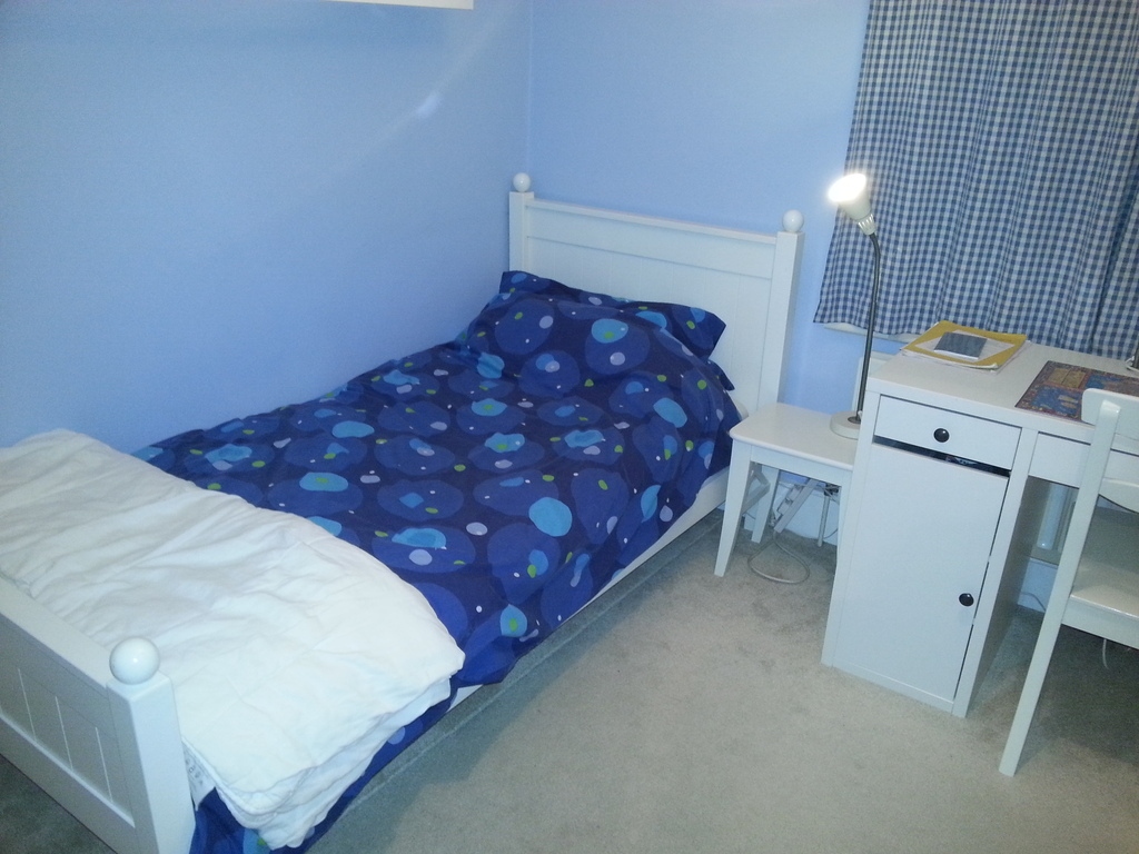 Bedroom with single bed on first floor