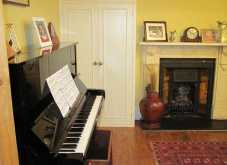 Second sitting room with piano.