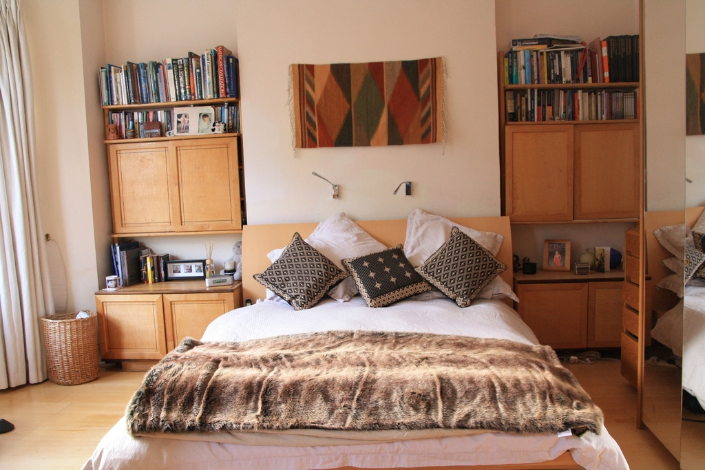 Our main bedroom with a king sized bed and many cupboards