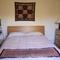 second bedroom with king sied bed overlooking garden