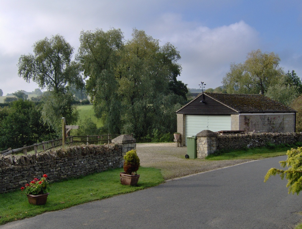 Parking area and garage opposite the cottage.
