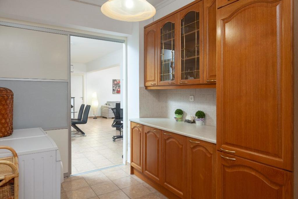 Kitchen Cabinets, washing machine and clothes dryer