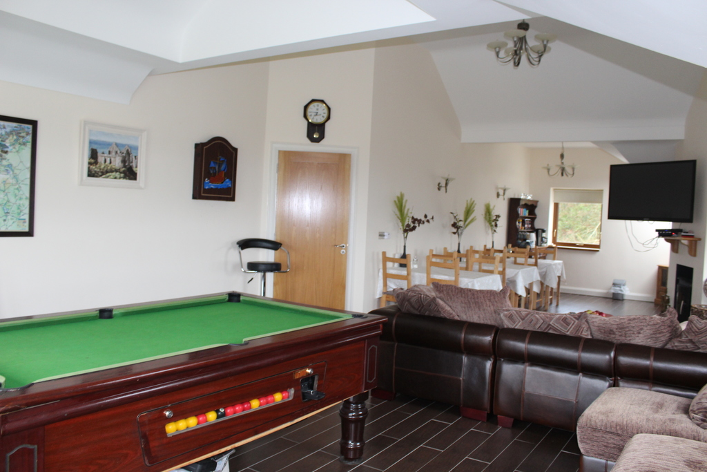 Upstairs games room with a balcony overlooking Lough Erne and the mountains