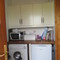 Utility room wit washer dryer, microwave and small freezer.