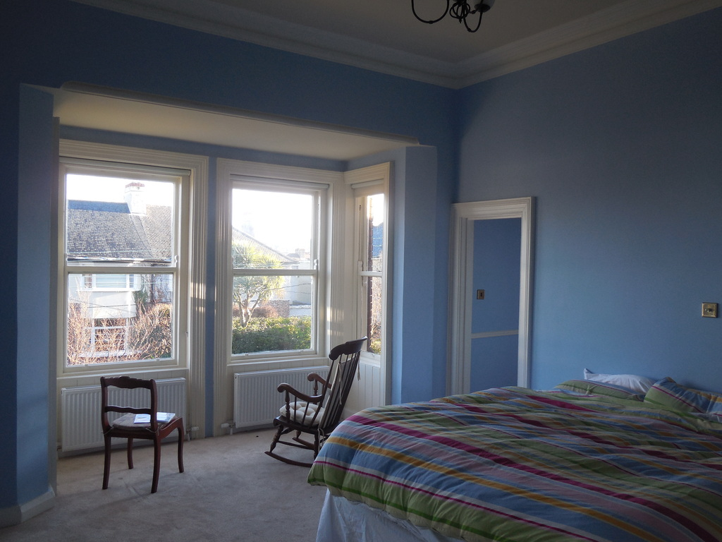 master bedroom with bright bay window