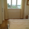 Double bedroom with shower and w.c. View of woods and harbour.