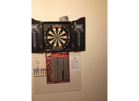Dartboard in bedroom 1