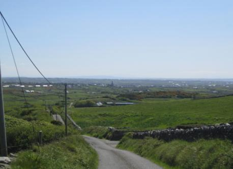 Local country road with the town/village of Milltown Malbay in the distance