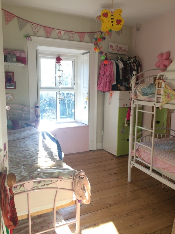 Children's room with single bed and bunk beds