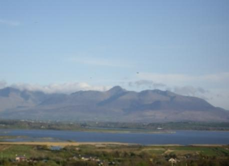 View of Carrauntowohill mountain, (highest mountain in Ireland, across the sea from the cottage.