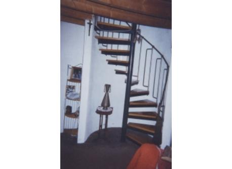 Spiral staircase to two small bedrooms