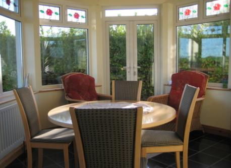 sunroom and dining room