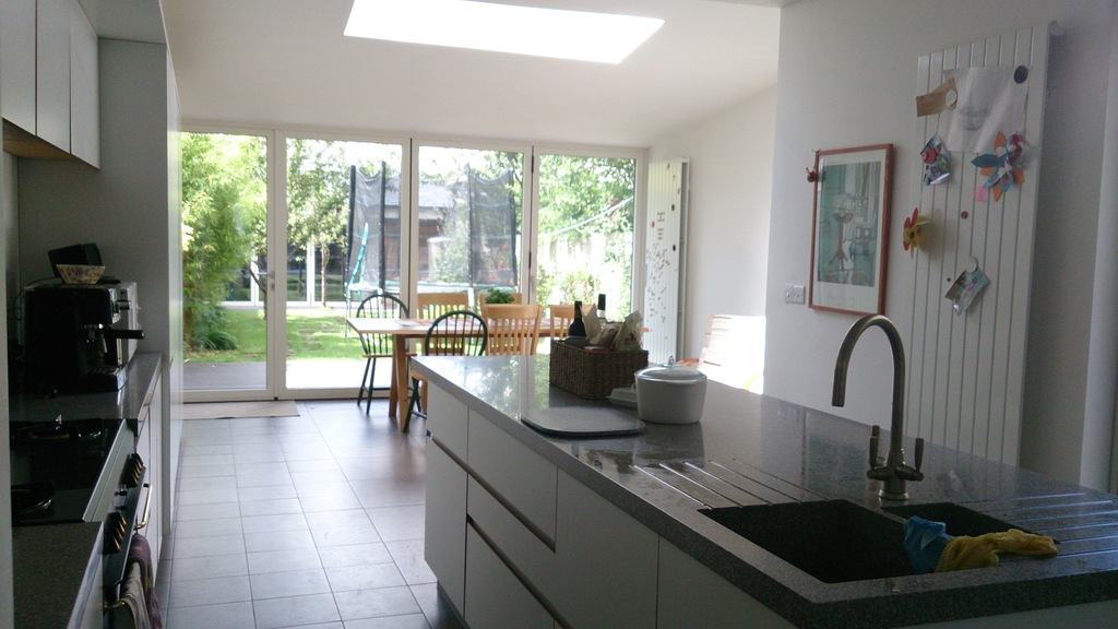 Modern kitchen area leading into garden
