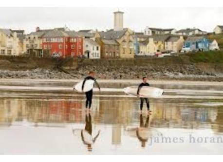 Surfing at Lahinch beach. Lahinch is a 40 minute drive from Quin.