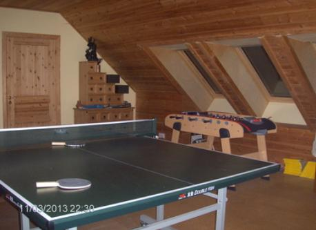 Upstairs has a sitting area with TV and a table tennis table.
