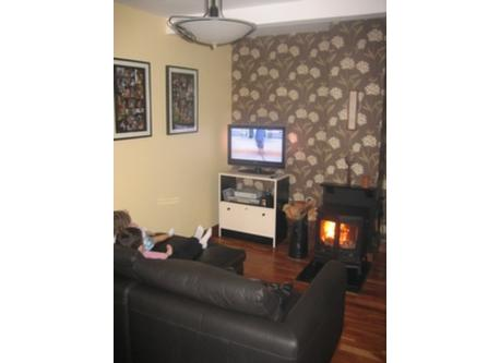 reception room 2 - family room, tv, real fire