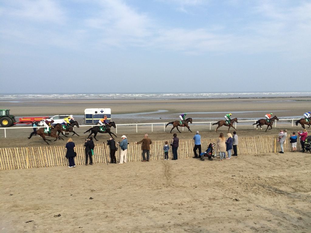 Horse racing on the beach