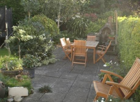 back garden patio, bar-b-q, rockery and pond