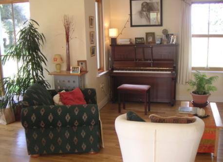 A sitting room with piano