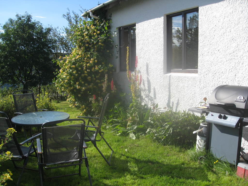 The barbecue and sitting area behind the house.