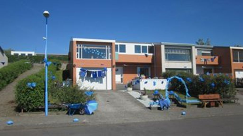 Our house during last summer, there was a town festival, we are in the blue neighbourhood