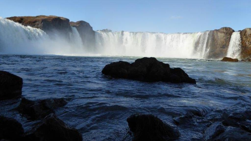 The Goðafoss waterfall is one of the most spectacular waterfalls in Iceland. The water of the river Skjálfandafljót fa