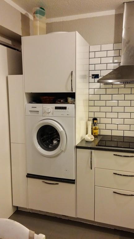 My washing machine is in the kitchen
