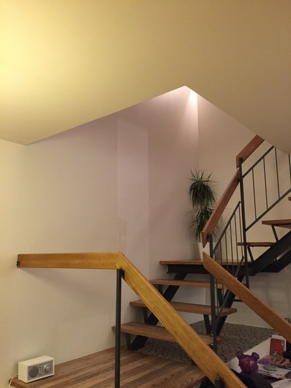 Stair from kitchen/living room to upper floor