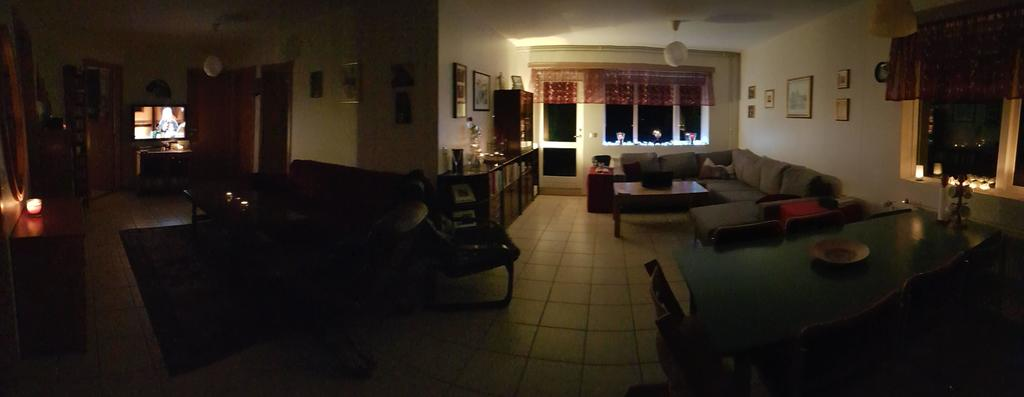Cozy time, panoramic photo of the TV area and the living room