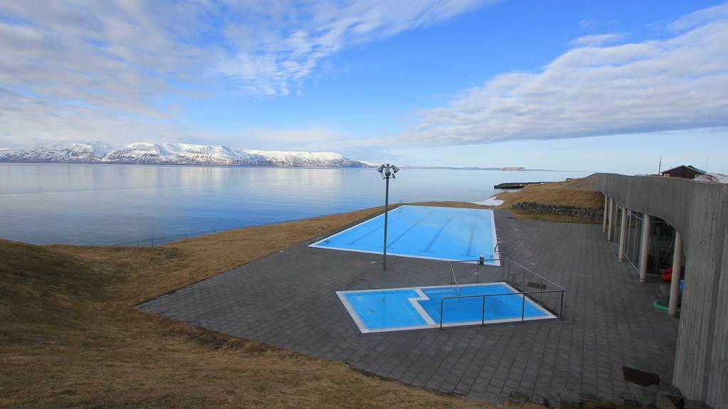 The swimming pool in Hofsós in northern Iceland.  A magnificent view of the nature from the pool.  About 3 hours from Búðardalur