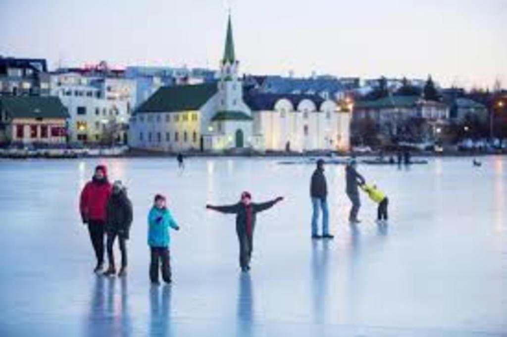 Ice skating on Tjörnin is popular in the winter