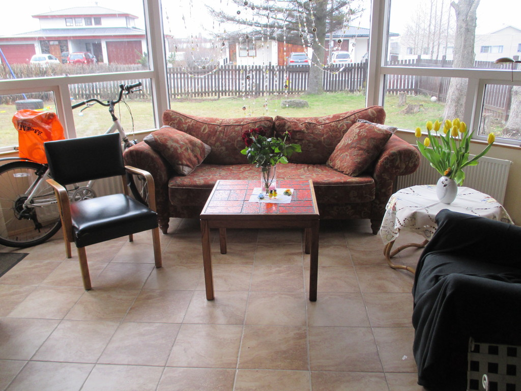 Living room and view to the garden in foggy easter day