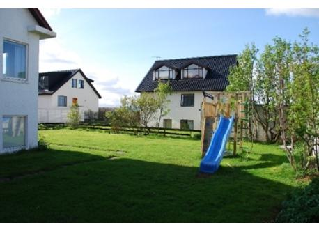 Garden, with a kid's castle and slide